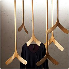 """schtick - Two hockey sticks fused together and fitted with a rare earth magnet, these hangers are custom made to fit your space In Lengths of [12"""", 24"""", 36""""  48""""]"""