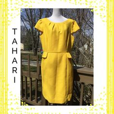SALE  Tahari Gorgeous Yellow Dress !   Gorgeous Tahari Arthur S Levine Dress !! Beautiful color almost like canary yellow ! Length is about 39 inches ! Back hidden zipper is 22 inches in length ! 3 inch peplum ! Little cap sleeves ! Dry clean ! She'll is 100% cotton ! Lining is 100% acetate ! Lining is same color as dress ! Armpit to armpit is about 44 inches ! Waist is about 36 inches ! Gorgeous !  Tahari Dresses