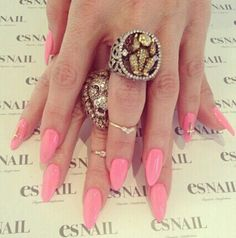 Pink acrylic tips almond shaped with precious pink and gold crosses