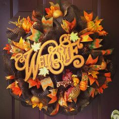 Very Limited Availability!! This 28 brown deco mesh wreath is bursting with fall colors!! Glittered chevron print, leaf print, and orange