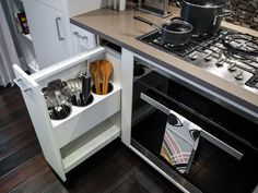 A pull-out drawer by the oven keeps cooking utensils out of sight but within easy reach.