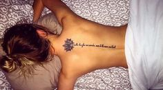 Scripture back tattoo with lotus.