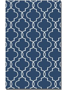 This Devonshire Blue Collection rug (71025) is manufactured by Uttermost. Woven, over dyed blue wool with off-white details.