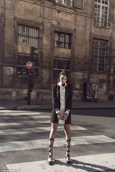 On duty beauty! Later, Shanina can be seen posing on a pedestrian crossing with her slende...