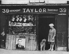 A local corner shop in Norfolk, England, where the proprietor is not only a funeral director but sells ironmongery plus glass and china. Victorian London, Victorian Gothic, Old Pictures, Old Photos, Funeral, 1920s, English Architecture, Store Window Displays, Ireland Homes