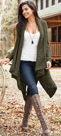 Olive knit cardigan over white tee and blue jeans with beige OTK boots.