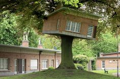 This sculptural tree house in Belgium was made for the art festival TRACK: A Contemporary City Conversion, and is a miniature version of the houses behind it.