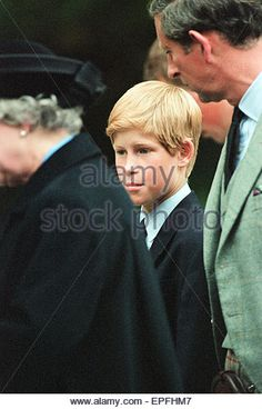 Royal Family, Balmoral Estate, Scotland, 5th September 1997.   After attending a private service at Crathie Church, Royal family stop to look at floral tributes left for Princess Diana, at the gates of Balmoral Castle.  Queen Elizabeth II Prince Charles P - Stock Image