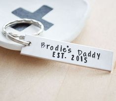 Daddy Established In 2017 Keychain.  Each keychain is stamped with your childs name and birth year.