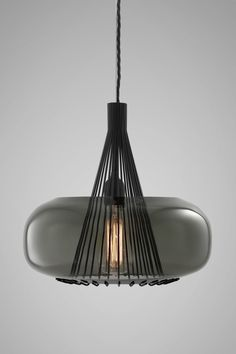 The Hooked Pendant Lamp consists of a seductively tinted hand blown glass shade…