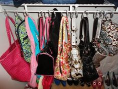 Use cheap shower rings to hang & organize purses in closet