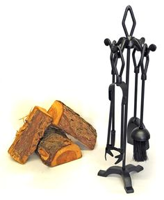 Saxon Fireside Companion Set - This iron companion set with black cast finials is a elegant fireside accessory. The holder and each tool is capped off with a black cast finial on the top.