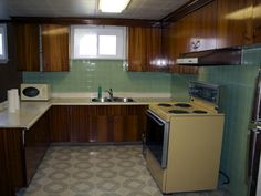 As seen on HGTV's Income Property, this basement apartment was dark, dingy and totally dated. Ugly vinyl floors and dark cabinetry left a lot to be imagined.