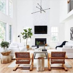 Friday Favorite: our French Modernist Chair making a major statement in bright white spaces. This breathtaking living room is courtesy of @jwsinteriors 👏🏼 📸: @stacyzaringoldberg #regram #repost #livingroom #wisteriastyle