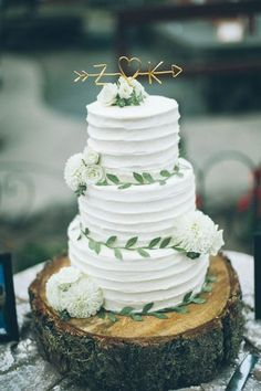 sweetest tree-trunk wedding cake with adorable golden topper via From The Daisies / http://www.deerpearlflowers.com/amazing-wedding-cake-ideas/
