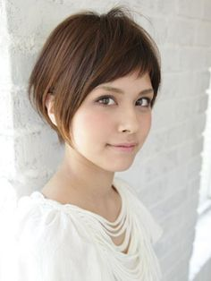 Show off your beautiful face with this shorter bob cut with side bangs.