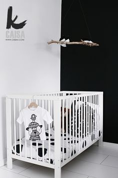 Caisa K.: black wall in a nursery, against a crisp white, wood branch mobile