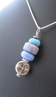 Blue and teal glass beads with silver Terra cast moon charm set