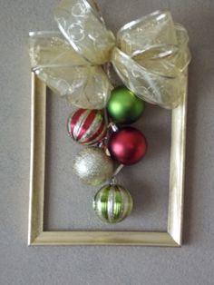 Christmas frame wreath for my front door with the help of http://adiamondinthestuff.com/2011/12/framed-christmas-wreath.html