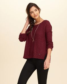A pretty sweater made with unique stitch detailing that creates soft texture, featuring a crew neckline, ribbed trim, a logo plaque at left hip and side hem slits, Easy Fit, Imported