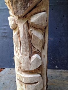And now, for something different, a tiki man carving