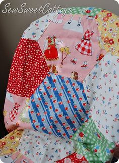 Paper doll and vintage fabric hexagon quilt
