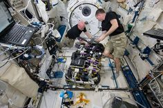 This week, the six-member Expedition 43 crew worked a variety of onboard maintenance tasks, ensuring crew safety and the upkeep of the International Space Station's hardware. In this image, NASA astronauts Scott Kelly (left) and Terry Virts (right) work on a Carbon Dioxide Removal Assembly (CDRA) inside the station's Japanese Experiment Module. The CDRA system works to remove carbon dioxide from the cabin air, allowing for an environmentally safe crew cabin.