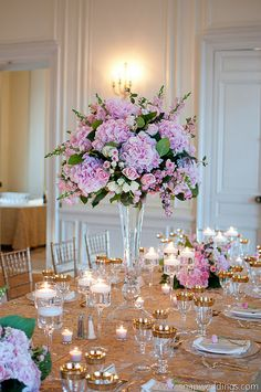 Pretty tall centerpiece with pretty pinks. I do like the occasional green pop of leaves. Good green/pink/white ratio.