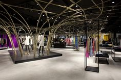 Smets Premium Store by Zoom Architecture Brussels Belgium incorporates large metal structure.