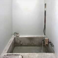 Square moulded cement bathtub, gun metal chrome spout, gun metal chrome tap and mixer, hand shower unit. Project by - @mstyleanddeaign #taps #interiordesign #bathroom #australia #architecture #bathroomdesign #bathroomcollective Visit our website for more www.bathroomcollective.com.au