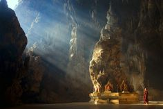 This majestic cave holds a Buddhist temple inside its depths.  Image Source: Deviantart user lintun79