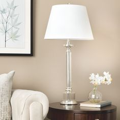 With sleek lines and a brilliant look thats certain to add distinctive flair to any room, this traditional crystal table lamp reflects light beautifully. This spectacular lamp is 31 inches high and comes with a cream-colored shade.