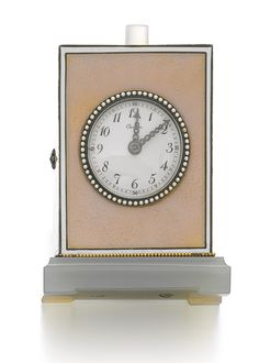 ENAMEL, AGATE AND DIAMOND MINIATURE TRAVELLING TIMEPIECE, CARTIER, CIRCA 1915. The rectangular guilloché enamel case set with a circular dial applied with black Arabic numerals and millegrain-set rose diamond hands, to a carved agate foot, with a polished cylindrical quartz push button, case measuring approximately 47 x 38 x 74mm, dial signed Cartier