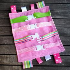 Great gift idea for the toddler who buckles EVERYTHING!! I actually made mine with buckles, snaps, overall hooks and velcro! I made it two sided and stuffed it like a pillow. My daughter loves it!!