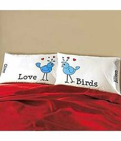 """Personalized Lovebirds Pillowcase Set by Personal Creations. $16.99. A Personal Creations Exclusive! A Whimsical Touch For Your Bedroom, Our Pillowcase Features A Cheery Blue Lovebird Surrounded By Bright Red Hearts. We Personalize Each One With Any Name, Up To 10 Characters. Our White Pillowcase Is Made Of A Machine Washable Cotton/Poly Blend Fabric. Measures 20""""L X 31""""W. Set Of 2"""