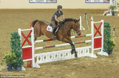 Champion: Kaley and a second horse coast across the course