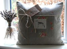 Hand Made cushion by Hilly Horton Home featuring Emily Bond Whippet appliqué on Moda Cabbages & Roses Panel. 40cm x 40cm cushion including quality feather pad. Super quality natural irish linen fabric. Reverse features a fully finished and generous envelope opening. All seams overlocked and double stitched for best finish. I am happy to ship overseas but please contact me in the first instance for a shipping quote. Listing is for cushion only, accessories not included. Any questions at al...