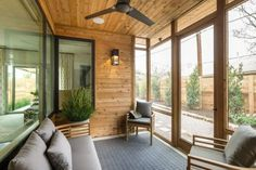 """""""We like the sense that we've kept it quiet. The chairs are all very sculptural and beautiful and because all of the wood tones are the same it keeps it interesting but it isn't too much. It's very much about being tied in to what's outside,"""" says interior designer Linda Woodrum."""
