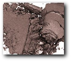 MAC MUST HAVE SHADOW: Satin Taupe. I have been purchasing this for years now. It seems to work beautifully with everything I pair it with...Pinks, golds--makes a great subtle smoky eye.