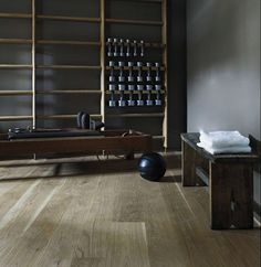 Interior by Ilse Crawford - gym at Ett Hem Boutique Hotel, Stockholm. Antique bench, Pilates reformer and gymnastic wall rack.