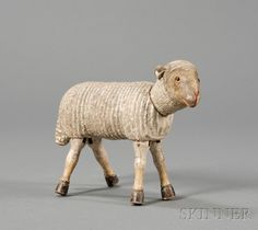 Schoenhut Painted Wooden Articulated Sheep Figure, Philadelphia, early 19th century, with glass eyes and leather ears, ht. 5 1/2, lg. 8 in.   Sold for $ 1,304