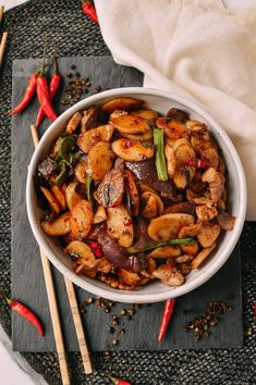 Spicy Stir-fried Rice Cakes with Sichuan Peppercorns - The Woks of Life Rice Cake Recipes, Rice Cakes, Spicy Recipes, Asian Recipes, Healthy Recipes, Ethnic Recipes, Rice Cake Noodle Recipe, Healthy Food, Korean Rice Cake