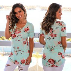 OMG! How cute does our floral criss cross top look in Mint?! Shop at savedbythedress.com