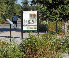 Located across the street from an elementary school, a series of panels along the Whittier Greenway Trail encourages study and cultivation of native and drought tolerant plants. Both photos and text keep family and student audiences in mind.