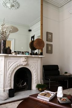 Ceiling rose, cast iron fireplace and mirror the whole chimney width and length