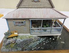 """Quarter Scale Dollhouses From the Spring 2014 Seattle Dollhouse Show: Sideview of the quarter scale cabin """"Pickett Pond"""" exhibited by Rosemary Shipman at the Spring 2014 Seattle Dollhouse Show"""