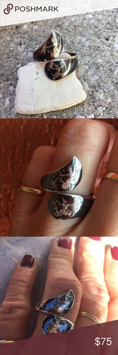 """Vintage Siam Ring Beautiful """"Vintage """" Find! This ring is So Unique and has so much history I'm tempted to keep it.  Sterling Silver with enamel has two different Thai Goddesses . 💖 Gorgeous! One side has some dings in Silver not visible when wearing and could possible be buffed by Jeweler if desired. Slightly adjustable Size 8 Jewelry Rings"""
