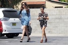 **EXCLUSIVE** Khloe and Kourtney Kardashian leave a 'secret' meeting with OPI, a nail manufacturer, after both tweeting about it