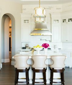 Great lighting and counter chairs   ~elegant kitchen design
