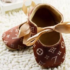 Baby Shoes New in package 12-18 months. Price reflects authenticity meaning it's not authentic Louis Vuitton Other